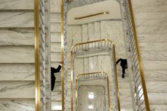 GOING UP: Two men held on to the banister as they ascended a staircase in the Rayburn House Office Building on Capitol Hill in Washington on Wednesday.