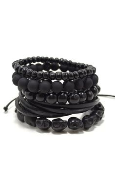 Set of 5 black bracelets, including, leather, wood, stone, and resin beaded bracelets. Available in 2 color variations. Free Domestic Shipping. Learn More