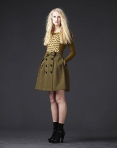 skirt with large button closure and bow at waist | O.Kiely
