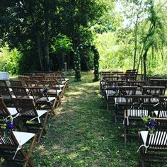 Secret garden wedding ceremony with our archway, with lots of local foliage and sprigs of gypsophila and hanging jars on the aisle chairs