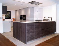 Bright orange utensils are added to this Watermark Kitchen adding depth to the kitchen space.