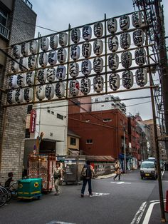 Asakusa Sanja Matsuri 2/2 ...and in some side-streets the scaffolds with the chochin lanterns by the matsuri donors are up. Preparations for Asakusa's big event, the Sanja Matsuri are well underway!  #Asakusa, #Sanja, #Matsuri, #chochin, #lanterns April 20, 2015 © Grigoris A. Miliaresis