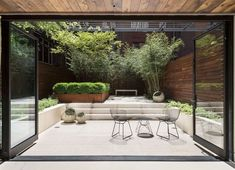 Huge glass doors really bring the garden into the house - How to Design a Minimalist Garden Photos | Architectural Digest
