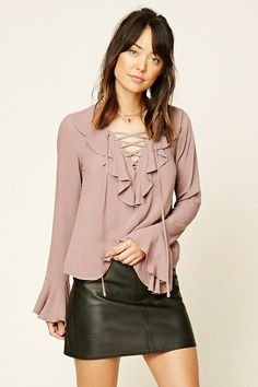 Contemporary - A woven top featuring a lace-up neckline with grommets, ruffled trim, and long bell sleeves.