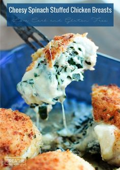 Low Carb Cheesy Spinach Stuffed Chicken Breasts - so keto and so delicious! Full of flavor too, with ingredients like garlic, eggs, almond flour, cream cheese and mozzarella!