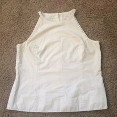 Lilly Pulitzer white size 8 sleeveless tank Lilly Pulitzer fully lined size 8 sleeveless white tank top buttons up the back 100% cotton 19 bust pit to pit 21 long Lilly Pulitzer Tops Button Down Shirts