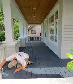 Love the deck color Cloverdale Paint's SharkSkin® Deck and Siding Stain in navy blue courtesy of Painting Painting! Deck Stain Colors, Deck Colors, Navy Blue Houses, Cloverdale Paint, White Deck, White Porch, Deck Repair, House Deck, House Roof