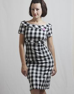 DIY Mad Men dress. A little too formal, would need something fun... Maybe the fabric pattern?