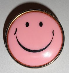 pink smiley face   i had one of these as a necklace