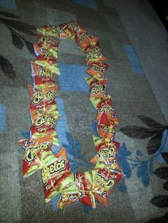 My hot cheetos lei for my nephews graduation. Diy Graduation Gifts, Graduation Leis, Candy Lays For Graduation, Money Lay For Graduation, Graduation Necklace, Money Lei, Jolly Rancher, Cap Decorations, Personalized Ribbon