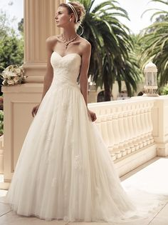 2108 Casablanca Wedding Dress - Strapless sweetheart neckline with soft tulle ruched bodice. The skirt is a gathered A-line silhouette. The Soft Tulle overlay features non-beaded lace appliqués scattered throughout the wedding dress.