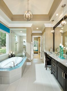 Arthur Rutenberg Homes. Love it all. The color combo with pops of blue, the window wall between the tub and shower, the lighting and ceiling details.