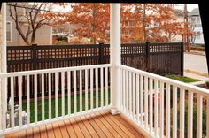 V5215-6 Semi-Privacy Fence with Old English Lattice shown in the Grand Illusions Color Spectrum Black (L105) Custom designed to match a White Victorian Home with black trim. Use Mix 'n' Match to correspond fencing colors with your home accents.