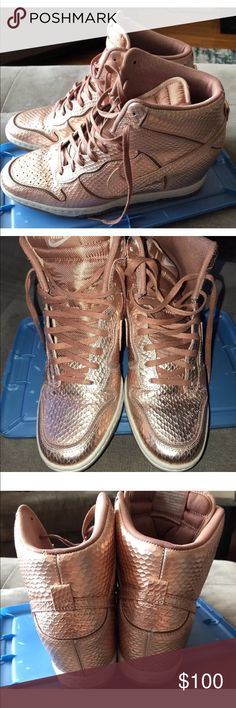 Nike Dunk Sky Hi Wedge Sneakers Rose Gold Nike Womens Dunk Sky High Wedge Sneakers (Limited Edition)  Size: 11 (true to size) Style#: 644411-900 Color: Rose Gold   Condition: Good Pre-owned Condition (Signs of wear - chipping and creasing in toe box as shown in photos) Ships without box  Questions? Just ask.  Price is firm, unless bundled. Nike Shoes Sneakers