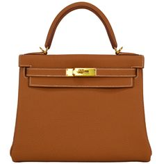 2014 Hermes Kelly Bag II Retourne  28cm Gold color Gold Hardware. | From a collection of rare vintage handbags and purses at https://www.1stdibs.com/fashion/accessories/handbags-purses/