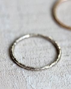 14k gold ring. This simple thin wedding ring or everyday ring is hand textured and distressed. The organic solid 14k gold ring has been hammered with a unique texture and each ring is one of a kind. A wonderful everyday ring or a special distinctive wedding ring. *** Orders are shipping 3 weeks from purchase *** Rush orders maybe possible. Please contact me for information before ordering to make sure I can accommodate your deadline. Thank you :). This listing is for ONE ring. The ring is…