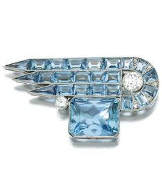 AN ART DECO AQUAMARINE AND DIAMOND BROOCH, CIRCA 1925. Of geometric design, millegrain-set with step- and calibré-cut aquamarines, highlighted with circular- and single-cut diamonds. #ArtDeco #brooch