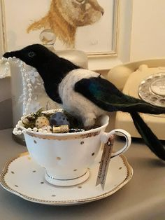Needle felted magpie and nest of treasure