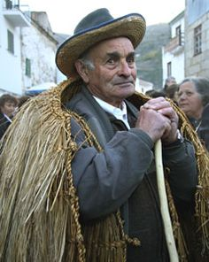 Villager in tradtional cape, Portugal.
