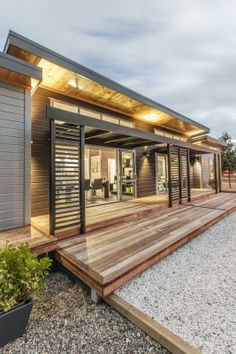 An exterior shot of the home at dusk. A beautiful Lockwood! The home plan is Skagen, designed and built by Lockwood. Dream Home Design, My Dream Home, House Design, Backyard Patio, Backyard Ideas, Wooden House, Pergola Designs, Minimalist Living, Commercial Design