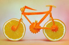 "Artist Dan Cretu Blends Food With Reality | ""Photographer and visual artist Dan Cretu recreates everyday objects out of fruits and vegetables. With his sculptures, Dan transforms common everyday eatables into recognizable objects. Thus a couple of oranges become a bike, cucumber is used for building a camera and popcorn transforms to a smiling face."""