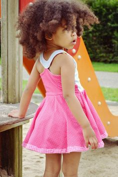 The Cyan Lily Dress & Tunic, a PDF sewing pattern by Mandy K Designs Size 12m to 14, plus coloring page. Changes to this dress: Skirt Shortened