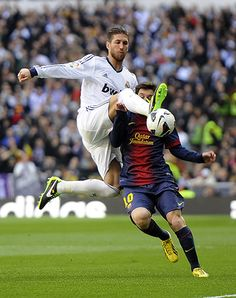 Sergio Ramos clears from Lionel Messi
