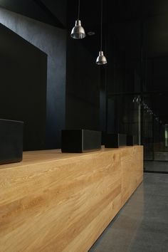 reception desk | at fernando botero library park | by g ateliers architecture.