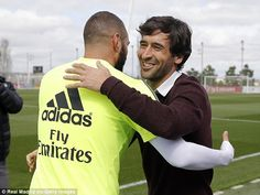 Karim Benzema (left) gives Raul (right) a hug after the former Spain international dropped by for a visit