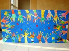 """Open House or Back to School Night project...create mural for wall outside classroom. Says: """"With heart and helping hands, a child can accomplish anything."""" by lora"""