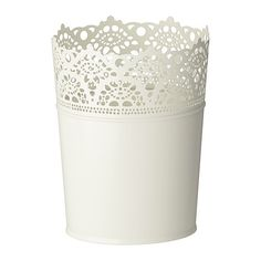 i bought a bunch of these lace plant pots from ikea...only $2.99...currently using them as small vases filled with white and yellow flowers...plan to use them to organize my craft space later on...