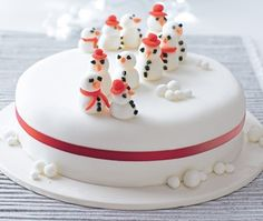 Igloo christmas cake 40 christmas cake ideas cake igloo cake christmas cake with white icing red ribbon tied around it with snowmen sitting on top publicscrutiny Image collections
