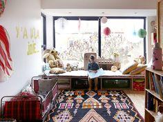 "Incredible vintage ""bric à brac"" joyful kid bedroom Colors, suitcases, kite, a lot of ethnic pillows..."