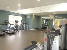 Fitness Center, equipped with free weights, elliptical machines, treadmills, ScullyFit Virtual Active cardio experience and more! #fitness #apartments #scullyfit #cardio