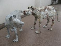 Tin dogs by Lucy Casson