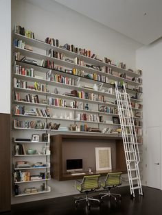 I have always wanted really high bookshelves with a sliding ladder... maybe one day!