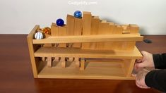 a mechanical marble climber with marbles that march up the stairs as you work the handle. Wooden Marble Run, Marble Toys, Wooden Art, Wooden Toys, Diy Wooden Projects, Woodworking Projects For Kids, Woodworking Toys, Arte Pink Floyd, Front Door Design Wood