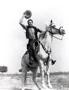 "John Wayne, Nicknamed: ""The Duke"". Always used his very own horse named, ""Dollar"" in all movie's were he rode a horse. (Dollar is featured in this photo being ridden by John)."