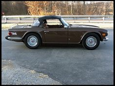 1974 Triumph TR6 Convertible.  I used to have a 1971 model of the same color.  I want another one.  :-)