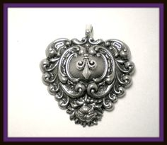 On Sale Fleur de Lis Pedant for Necklace-Art Deco Nouveau Victorian Goth Rock Punk Vampire Twilight 18. $12.00, via Etsy.