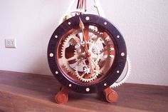 """The gears (or """"wheels"""" as clock makers call them) are made of aircraft quality birch plywood made in Finland. The dark wood of the dial is an African hardwood called wenge and the frame is jatoba or Brazilian cherry"""