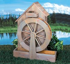 Old Grain Mill Wood Project Plans This nostalgic project was modeled after the grain mills that used to dot our countryside. It features a working water wheel and is made entirely from standard size cedar boards. #diy #woodcraftpatterns