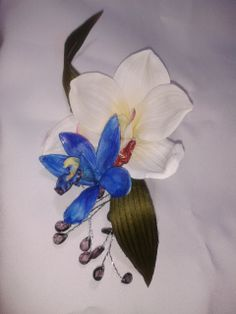 Blue and white orchid hair clip with crystal accents and tropical greenery