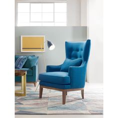 William is a wing chair for today, modernized with a button-tufted curved back and low relaxed arms. Finished with a T-cushion for comfort and set on turned legs.