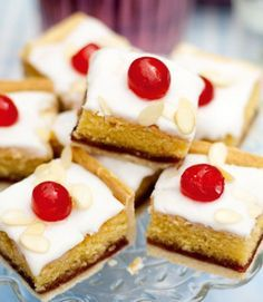 Iced bakewell tart tray bake Take the classic bakewell tart recipe and make it into a tray bake in this recipe. A golden layer of shortcrust pastry topped with an almond cake, strawberry jam, icing and glacé cherries. Tray Bake Recipes, Dessert Recipes, Baking Recipes Uk, Bake Sale Recipes, Layer Cake Recipes, Iftar, Shortcrust Pastry, British Baking, Profiteroles