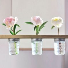 Spruce up your space with a DIY mason jar flower shelf! tutorial at http://www.withlovely.com/diys/diy-mason-jar-flower-shelf