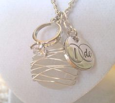 """A piece of beach glass wirewrapped in tarnish free silver wire and paired it with a crystal engagement ring and silver """"i do"""" disc. This necklace is a special one of a kind gift to give at a wedding shower or engagement party! it is also a lovely anniversary gift....chain length is 18"""" or 20"""" your choice.    SOLD BY SUSAN SUSANSEAGLASSDESIGN.ETSY.COM"""