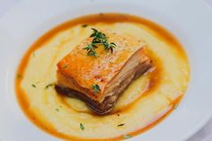 Easy recipe of a great dish, belly pork with parmesan polenta, Hennessy cognac and butter sauce. Crispy belly pork crackling, soft polenta and a rich sauce. Butter Sauce, Pork Belly, Spanakopita, Polenta, Parmesan, Carne, Bacon, Easy Meals, Dishes