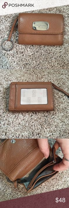 Michael Kors Wallet Key ring style Michael Kors wallet, visible ID slot on the back, coin zipper pocket and card slots on the inside! Worn but in good condition! Size is convenient to fit in any purse 👍🏼 Michael Kors Accessories