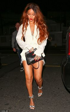 Style star: With her long tresses left loose in cascading waves, Rihanna looked nothing sh...
